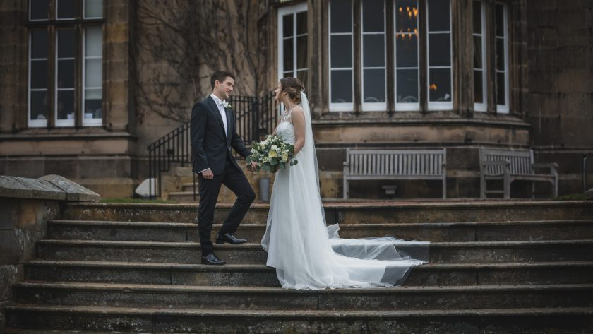 The Bride and Groom on the Steps of Matfen Hall, Image by Stan Seaton Photography