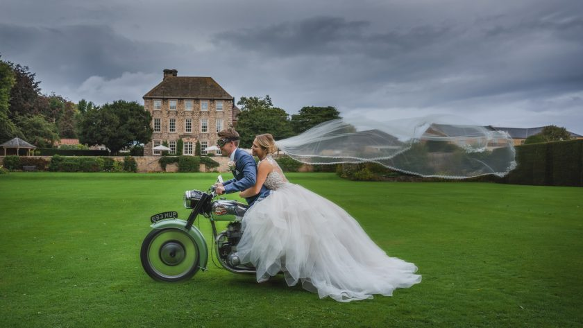 The Bride and Groom on a Motorbike, Image by Stand Seaton Photography