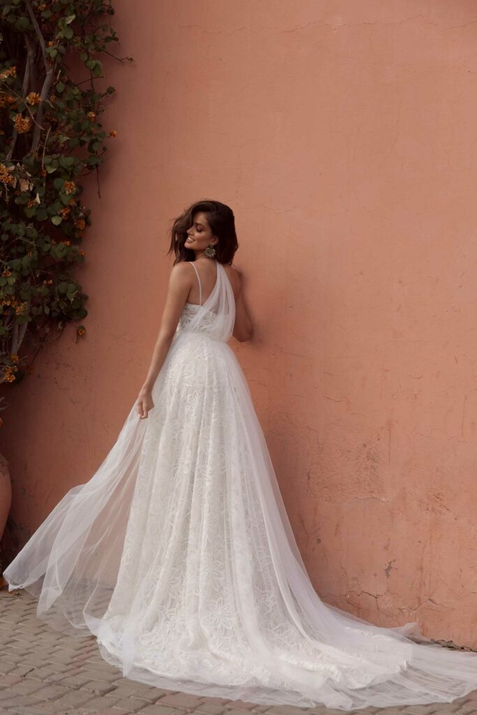 AZARIA-ML17518-FULL-LACE-GOWN-WITH-PLUNGING-NECKLINE-FITTED-BODICE-AND-FLOATY-SKIRT-LOW-BACK-AND-ZIPPER-WEDDING-DRESS-WITH-DETACHABLE-TRAIN-MADI-LANE-BRIDAL5