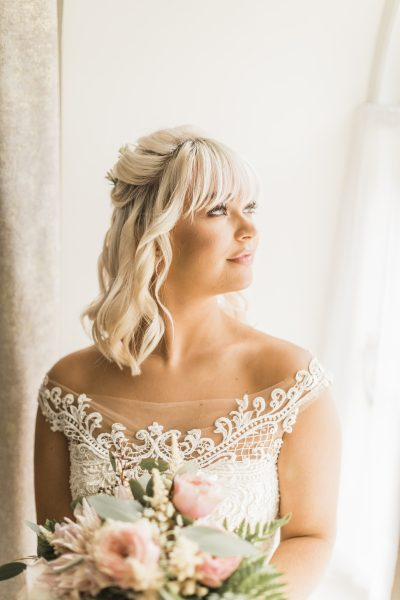 Hair and Make-up by MEIA. Dress by Maggie Sottero. Image by Katy Melling