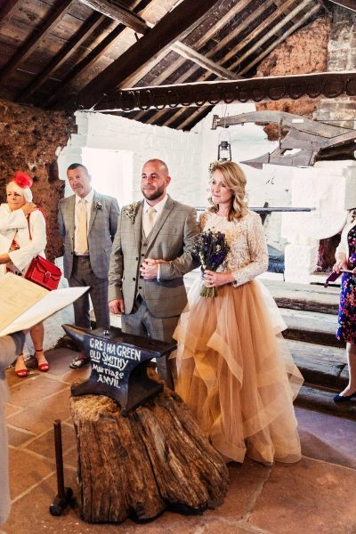 The Bride and Groom with the Anvil, Phtoographed by Camilla Lucinda Photography