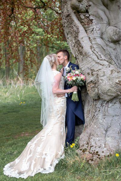 Jo and Joe kissing under the tree