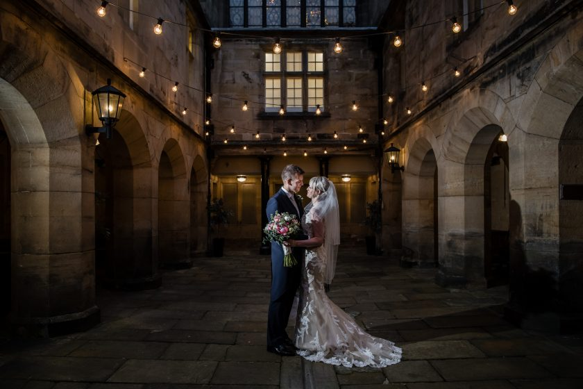 Bride and Groom Outside of Matfen Hall at Night